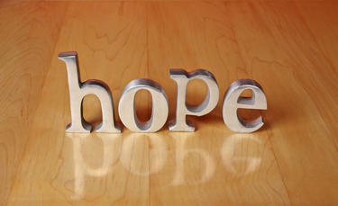 The letter HOPE on a table.