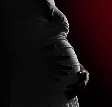 Pregnant women holding her belly.