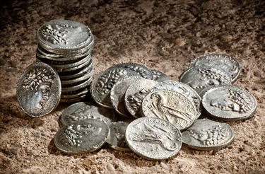 Old coins representing 30 pieces of silver.