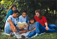 A group of teenagers studing the Bible