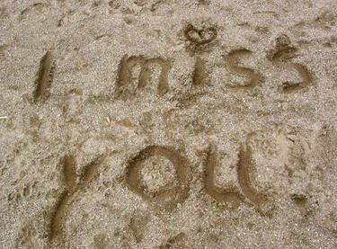 words I miss you written in sand