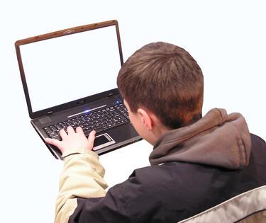 teenage boy using laptop computer