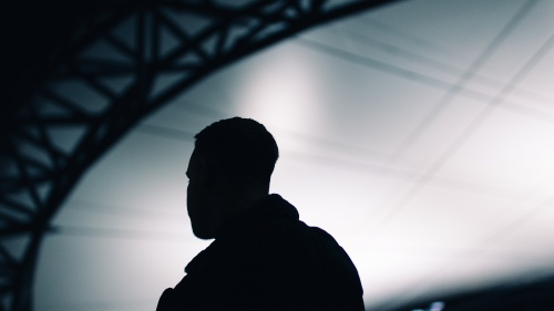 A silhouette of young man.