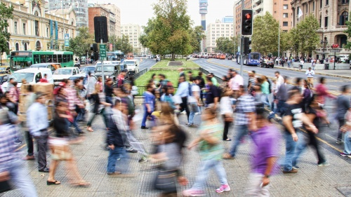 A blur of people walking in a busy city.