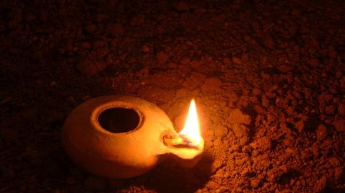 A clay oil lamp.