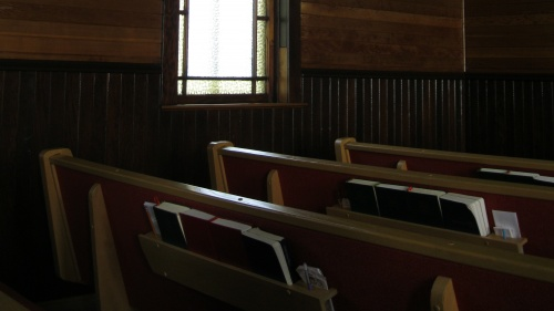 Pews inside a church.