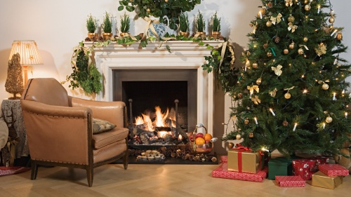 A Christmas tree in a festively decorated living room.
