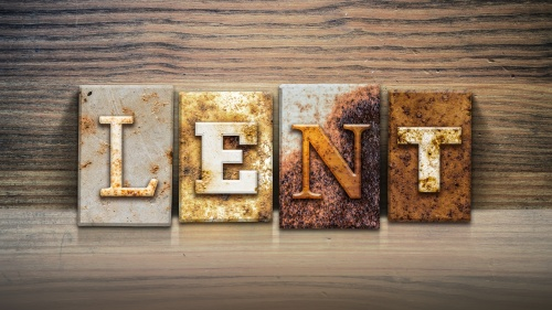 """A block letter sign that spells out the word """"Lent""""."""