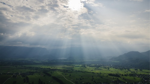 Sun rays coming through the clouds.