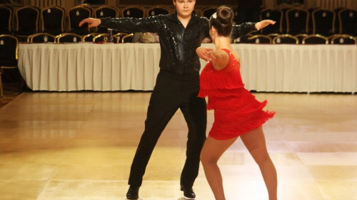 Alexander Schweitzer with his dance partner Tina Freitag, competing at the Wisconsin Dancesport Championship.