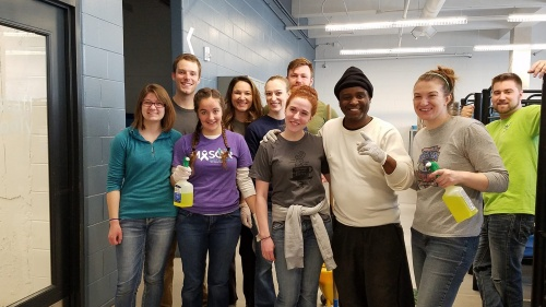 Participants of the young adult weekend, volunteering at the David and Rebecca Barron Center for Men.