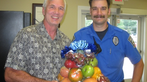 Richard Kennebeck shares a fruit basket with the local police department.