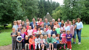 Campers and staff pose for a group photo at the German and Dutch camp in Germany.