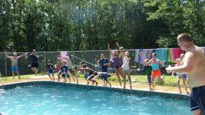 Campers cool off in the pool at camp Seven Mountains.