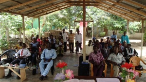 Brethen in Kwanyako, Ghana at the current meeting location. Located under low power lines, this open air structure has been condemned by the local government.
