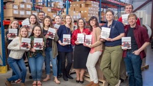 Pictured are ABC students and staff who worked on the cookbook.