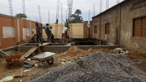 Photo of workers building the expansion of the school.