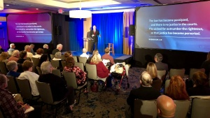 Darris McNeely speaking in Garden Grove, California.