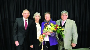 Mr. and Mrs. Kubik standing with Mr. and Mrs. Antion at Winter Family Weekend.