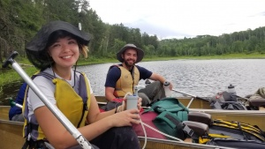 Photo of two campers in a canoe.