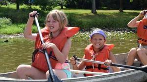 Campers enjoying the rowboat activity.