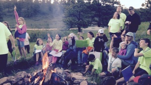 Campers and staff around the fire.