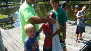 Campers fishing with staff.