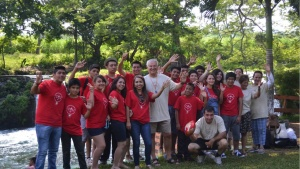 Campers pose and wave at the camera with Mr. Seiglie.