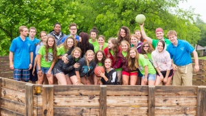 Campers and staff pose for photo at Camp Cotubic.