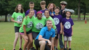 A photo of camp and staff posing.