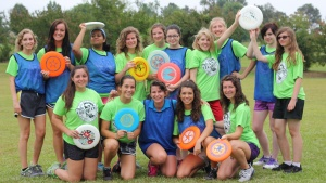 Girls dorm taking part in the frisbee activity at Camp Woodman.