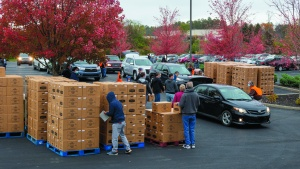 More than 60 people volunteered to assist directing traffic, loading cars and restocking boxes.