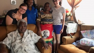 During Linda Merrick's visit, she was able to visit with some of the brethren in their homes. From left to right: Lena VanAusdle, Juliana Kachali, Esther Chilopora, Linda Merrick and Samuel Chilopora (sitting).