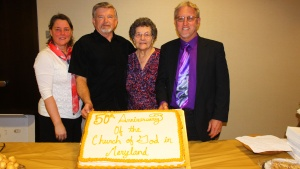 Members of the Maryland church show off the 50th Anniversary cake.