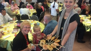 Sweet treats were part of the annual senior citizens appreciation brunch in Fort Wayne the Sabbath of Aug. 8. Montana Hermann, assisted by Tiffany Borton, were part of the serving crew.