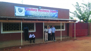 Victor and Bev Kubik stand with Joseph Mughogho, the LifeNets Business and finance manager in Malawi. The building they are standing in front of is the LifeNets Internet Cafe and grocery store.