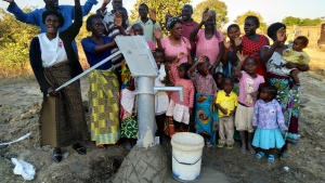 LifeNets recipients in Chipata elated over the new borehole to provide them with fresh water.