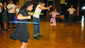 the Los Angeles congregation event had a 1950s theme with a hula hoop contest.