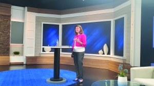 Photo of Julie Brown presenting an analysis of the results.