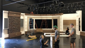 Workers installing the new Beyond Today set in the new studio.