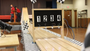 Photo of the racetrack used for the New England Pinewood Derby.