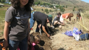 Participants of the weekend digging for fossils.