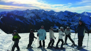 In this photos skiers pose in front of a magnificent view of mountains. Visitors from various parts of the U.S. came to Utah for the Salt Lake City Ski Weekend.