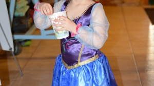 Isabelle White dressed as a TV princess enjoying a hot chocolate drink.