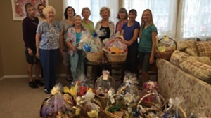 The ladies from the Spokane fellowship group pose with their baskets they filled for shut-ins.