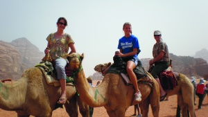 Wadi Rum in Jordan at the Feast of Tabernacles 2010. In this photo Stella is (at the right wearing a hat) riding a camel with friends Alyssa Diggins and Mary Miller.