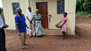 Elderly couple receiving keys to home built for them by Good Works in Chipata.