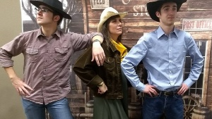 Roundup Trio: Sherry Kenady and her sons Brad and Kurtis strike a playful pose at the Roundup.