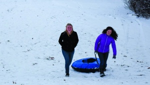 After a few inches of snowfall, campers and staff were able to go tubing and enjoy fellowship outside.