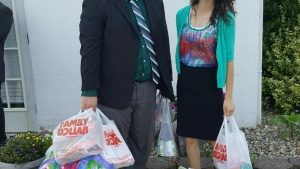 Ben Shoemaker and Chelsea Shaw with items they collected for the Women's Crisis center in Maysville, Kentucky.